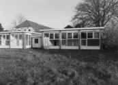 Deze kleuterschool verving de in 1928 gebouwde houten ''noodschool'' aan de Schoolstraat. In 1984 werd ook deze school buiten gebruik gesteld. Door veranderingen in het onderwijs werden de kinderen ondergebracht bij de openbare lagere scholen ''Flambou'' en ''Trimbeets''